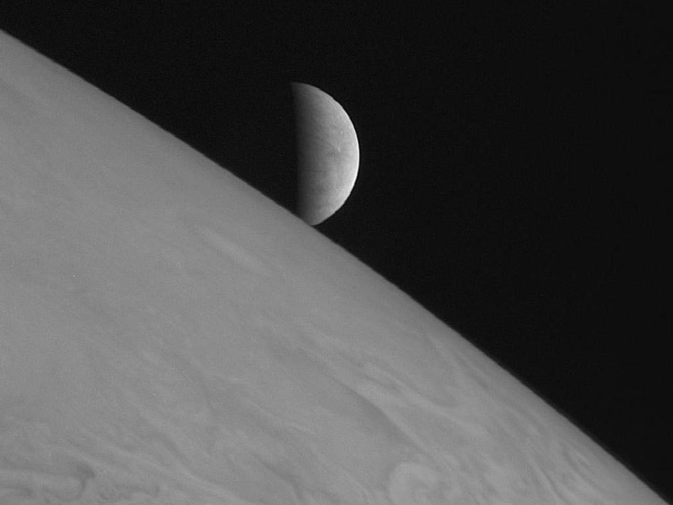 New Horizons took this image of the icy moon Europa rising above Jupiter's cloud tops after the spacecraft's closest approach to Jupiter.