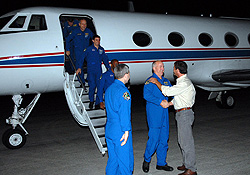 STS-122 crew arrive at Kennedy