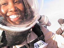 LaTasha Taylor wearing a helmet with a clear mask in front of her face