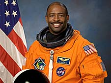 Leland Melvin in a training version of his orange launch and entry spacesuit