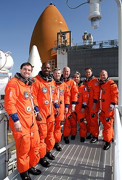 The STS-122 mission astronauts complete training