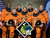 The seven STS-122 crew members wearing training versions of their orange shuttle launch and entry suits