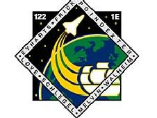The STS-122 mission patch features the names of the crew members, an old sailing ship and a space shuttle