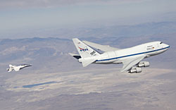 NASA's Stratospheric Observatory for Infrared Astronomy, SOFIA, is shadowed by a NASA F/A-18 mission support aircraft during a recent test flight.