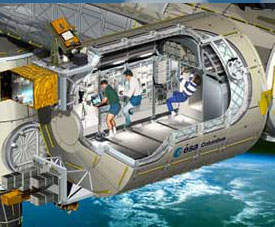 A cutaway drawing of the Columbus module showing the crew working inside