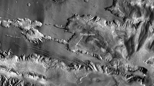 southwestern portion of Mars's Candor Chasma and part of the large canyon system Valles Marineris