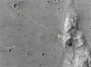 image of Mars Exploration Rover Spirit crossing northward on a low plateau called