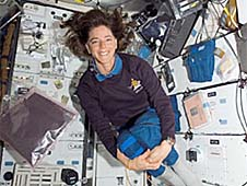 Barbara Morgan floating inside the space shuttle