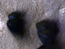 bright streaks and dark fans on Mars