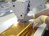 Worker sewing thermal blanketing