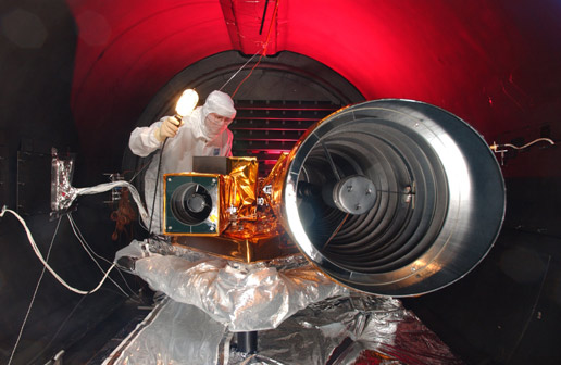 engineer performs configuration check of spacecraft's telescope assemblies