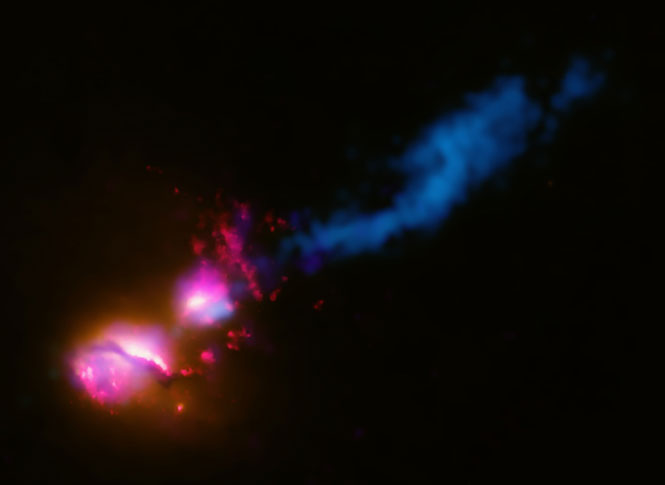 A jet from a black hole at the center of a galaxy strikes the edge of another galaxy.