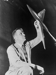Richard T. Whitcomb inspects a wind tunnel model based on his 'area rule' concept in 1954
