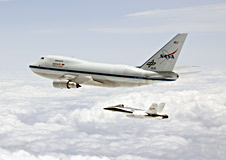 NASA's SOFIA airborne observatory is shadowed by a NASA F/A-18 aircraft.