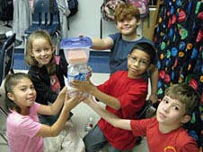 Third-graders at Oak Hills Terrace Elementary School design plant growth chambers