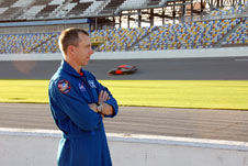 NASA astronaut Drew Feustel watches NASCAR racers practice at Daytona International Speedway.