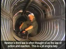 A test pilot sits in the bay of a jet engine