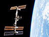 The International Space Station and a partial view of Earth