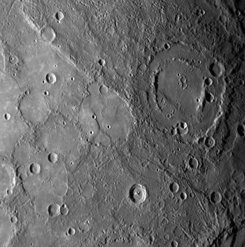 The double ringed crater pictured in the upper right of this image appears to be filled with smooth plains material, perhaps volcanic in nature.