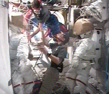 Crew members prepare for spacewalk