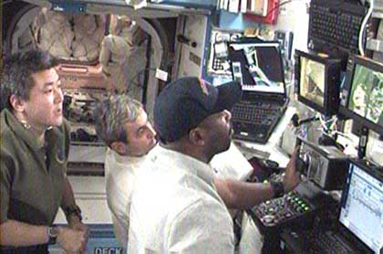Crew operates station robotic arm