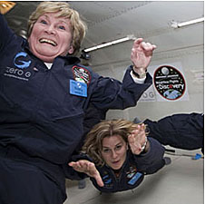 Eileen Poling and Katya Denisova float inside of an airplane
