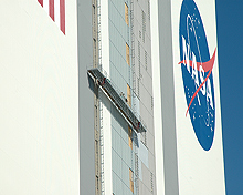 Workers on the Vehicle Assembly Building