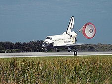 The drag chute slows down the landing of Atlantis