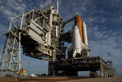 Space shuttle Endeavour stands poised for launch.