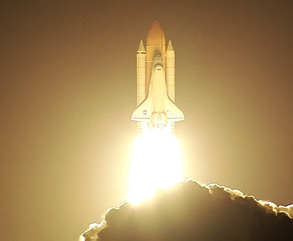 Space shuttle Discovery launches.