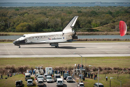 Discovery rolls down the runway after landing