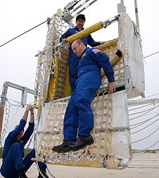 STS-123 astronauts practice launch pad egress