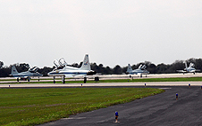 STS-123 astronauts depart Kennedy in their jets