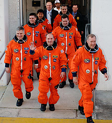 STS-123 astronauts walk out of Operations and Checkout  Building
