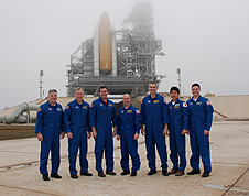 STS-123 astronauts pose in front of Endeavour
