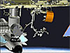 The station robotic arm removing the Canadian Special Purpose Dexterous Manipulator