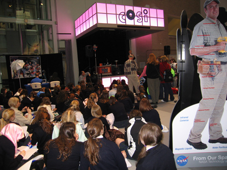 Astronaut Carl Walz gives presentation in NASA Exhibit Area.