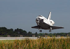 Space shuttle Atlantis lands.