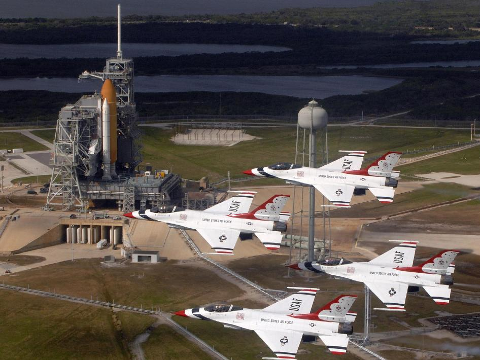 U.S. Air Force Thunderbirds fly past space shuttle Endeavour onLaunch Pad 39A.