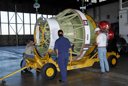 workers prepare the Delta II second stage for GLAST for weighing