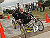A moonbuggy clears an obstacle