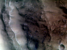 Image showing infrared brightness of the central peak and wall of a crater in Tyrrhena Terra, in Mars' southern highlands