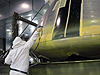 Painter applies primer coat to NASA's Orion test crew module