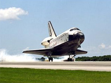 Space shuttle landing at Kennedy Space Center.