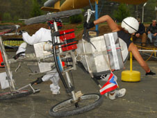 A pair of intrepid student drivers from Puerto Rico High School in Fajardo, Puerto Rico, endure a fearsome, buggy-flipping crash early in the day during the high school division of NASA's 15th annual Great Moonbuggy Race.