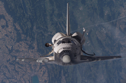 Station Bound-Space shuttle Discovery, commanded by Eileen Collins (STS-114), approaching the International Space Station on July 28, 2005.