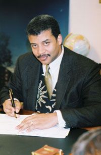 "Carrying the fire-Astrophysicist Neil deGrasse Tyson has carried on Carl Sagan's tradition of helping inspire the public about the wonders and mysteries of space exploration. Photograph by Dan Deitch for PBS / NOVA ""Origins"""