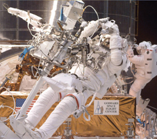 Image of an astronaut on a spacewalk during a previous servicing mission.