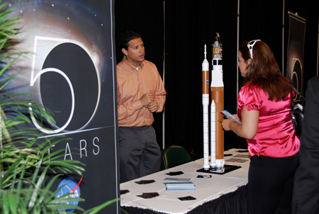 NASA displays an exhibit commemorating the agency's 50th anniversary during a Future Forum in Miami that focuses on how space exploration benefits Florida's economy.