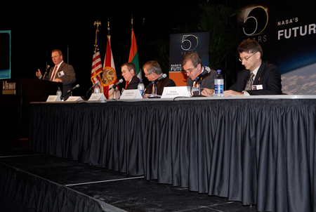 "From the podium, Douglas Comstock, director of NASA's Innovative Partnership Program, moderates a panel presenting the topic ""Unleashing the Power of Technology and Creativity"" during NASA's Future Forum in Miami."
